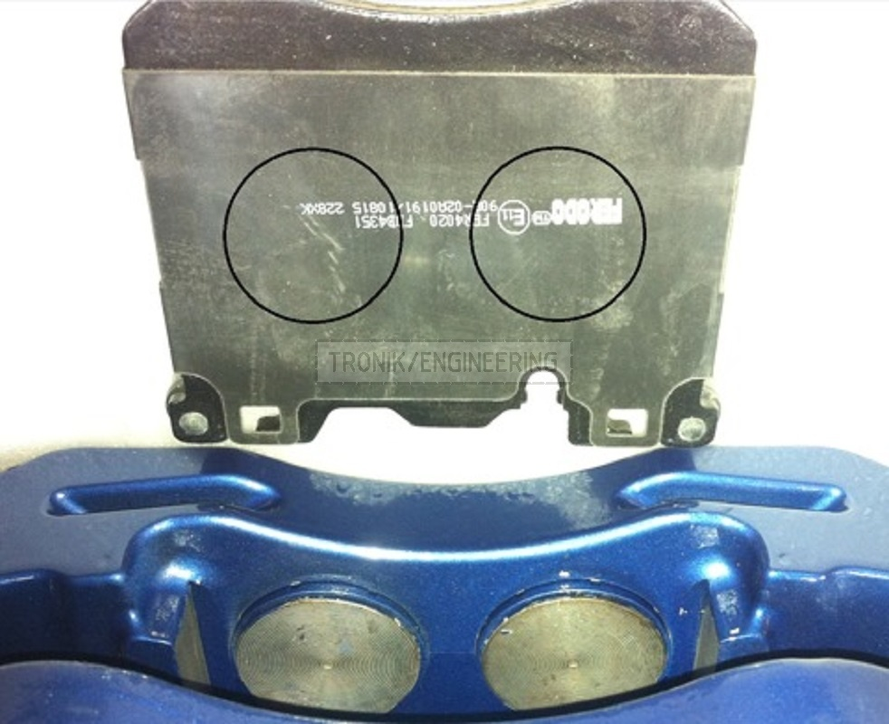 Brake pad is made very tall and narrow, pistons are of same size