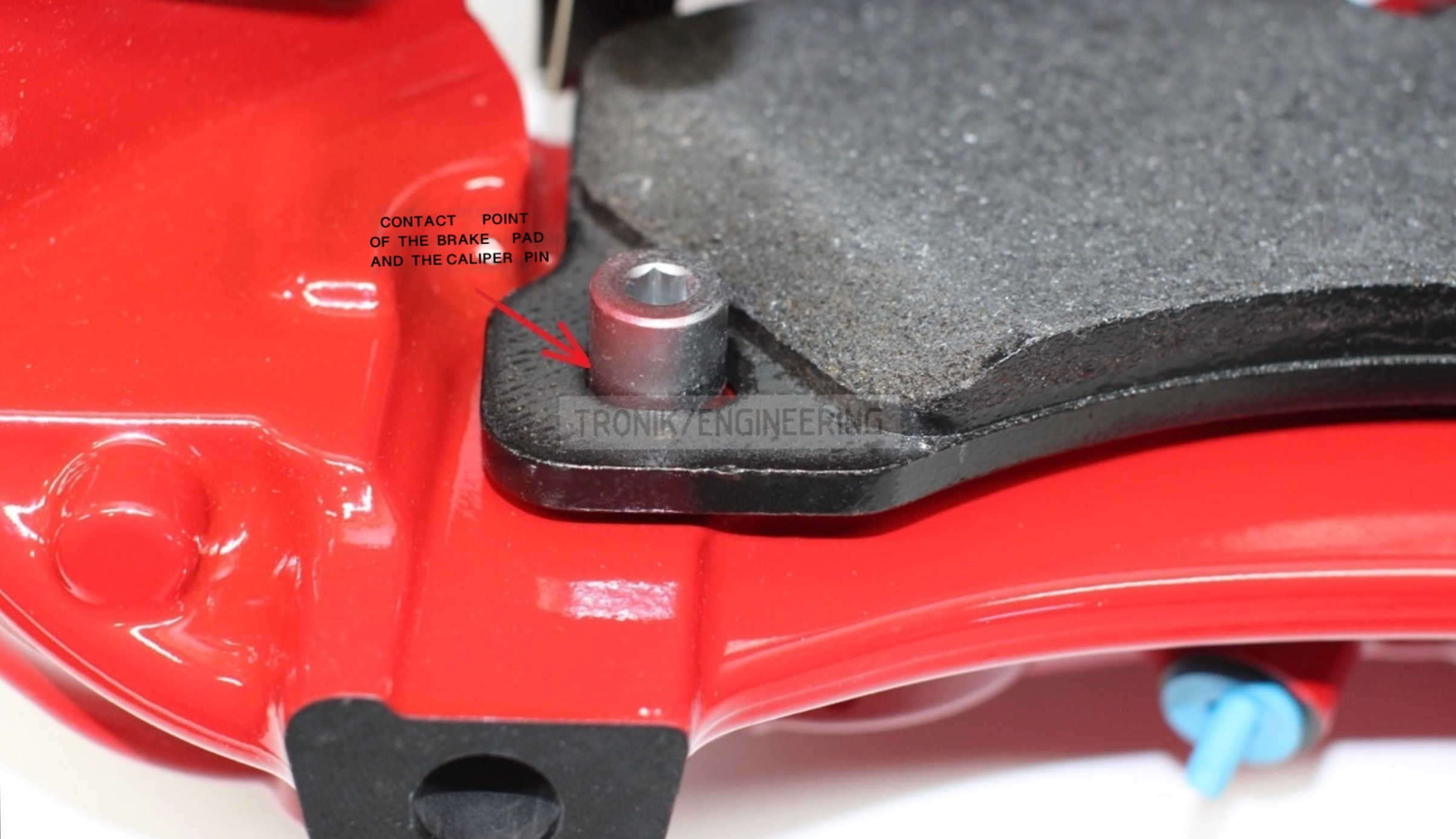 contact point of brake pad and caliper pin