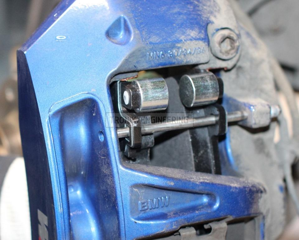 insert brake pads and pins until distinctive click