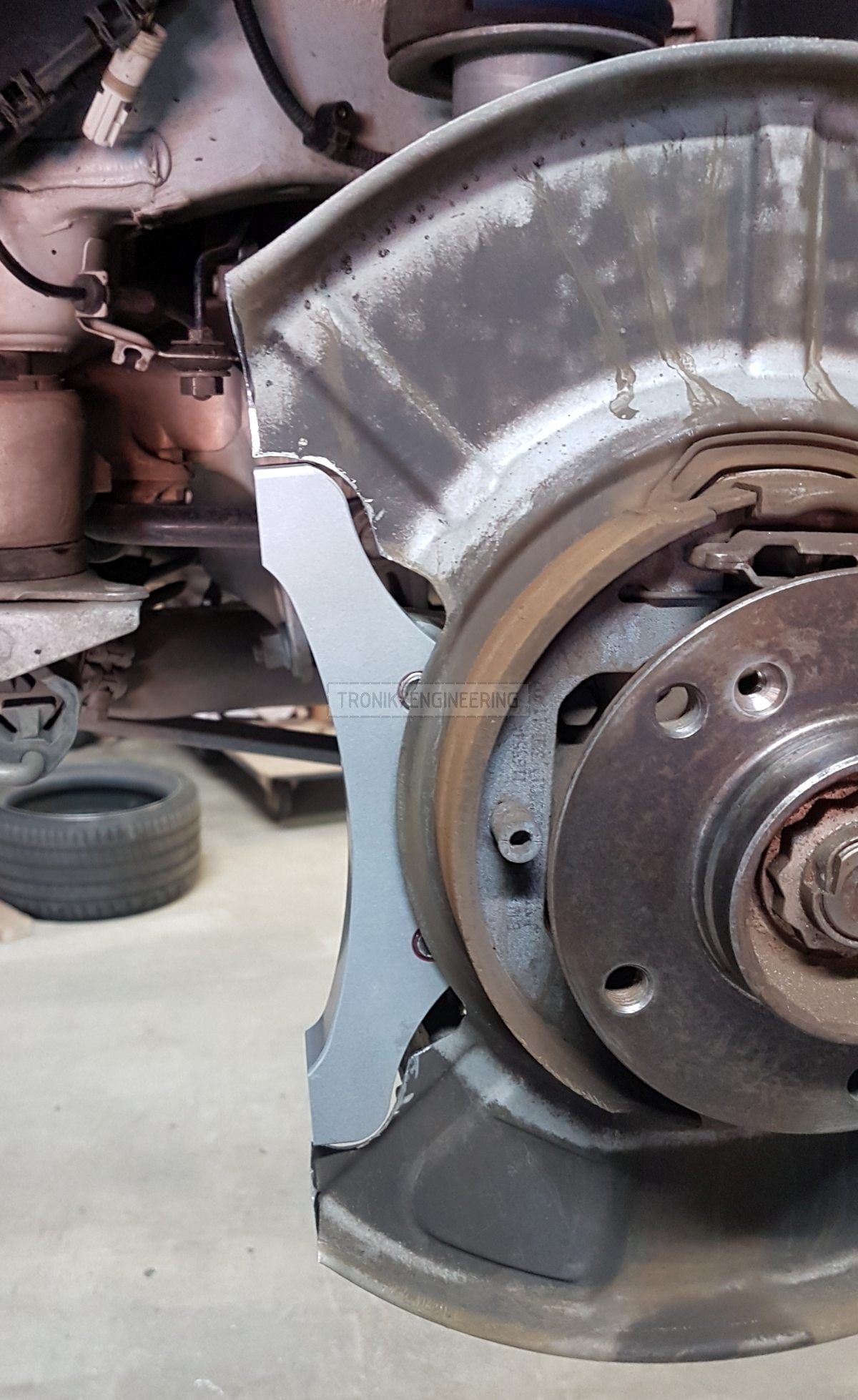 rear axle caliper adapter installed