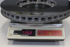 Weight of front right carbon-ceramic rotor is 7 350 g.