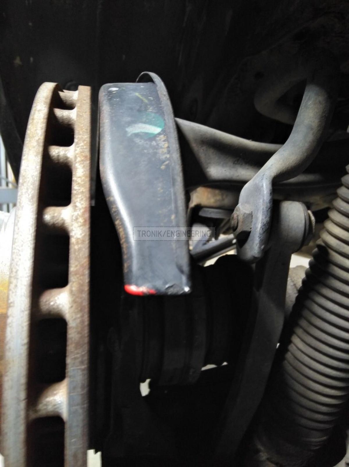space between molded dust shield & brake rotor