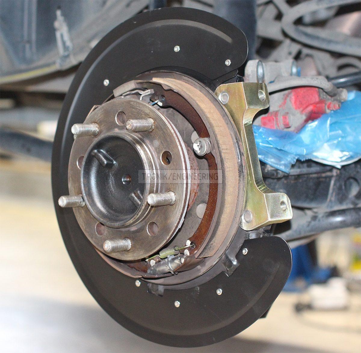 rear brake rotr protection & caliper adapter pic 2