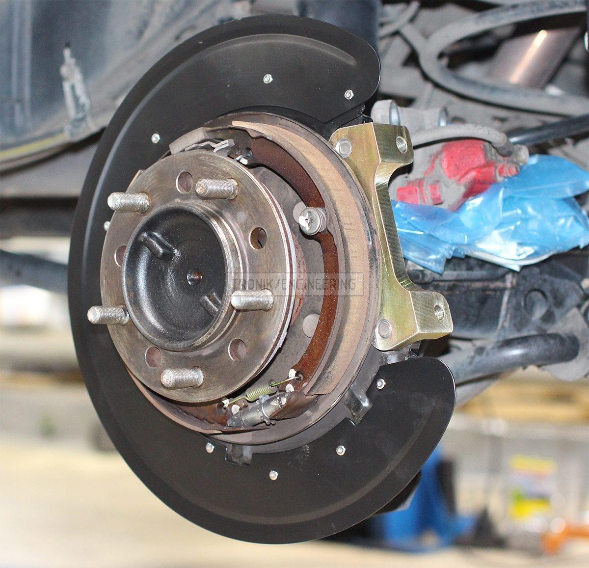 rear brake rotr protection & caliper adapter pic 3