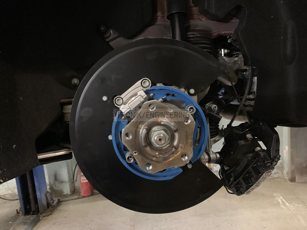 dust shield for bigger brake rotor